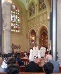 Fr Peter Meo praying over Christian Irdi